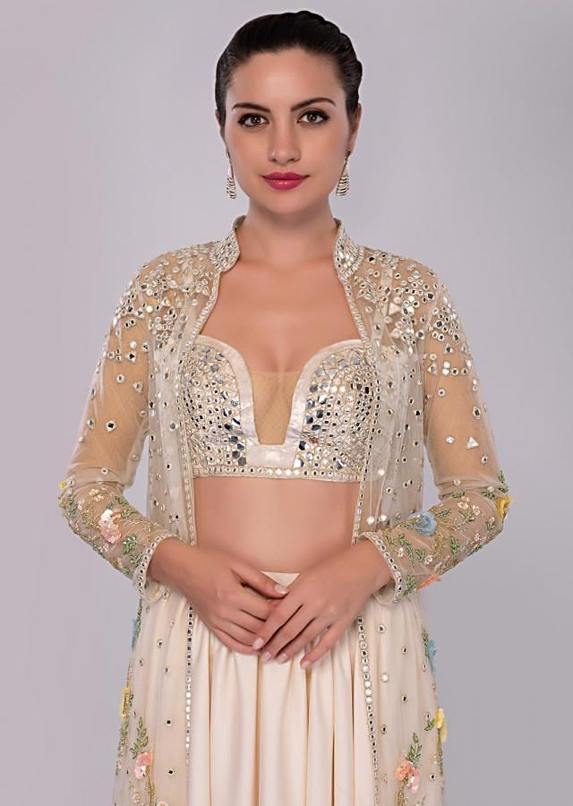 Lace pink pleated skirt and matching bustier paired with long embroidered net jacket only on Kalki