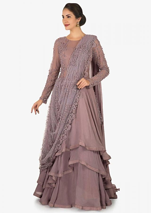Lavender gown in georgette with ready pleated pallav embellished with moti work only on Kalki