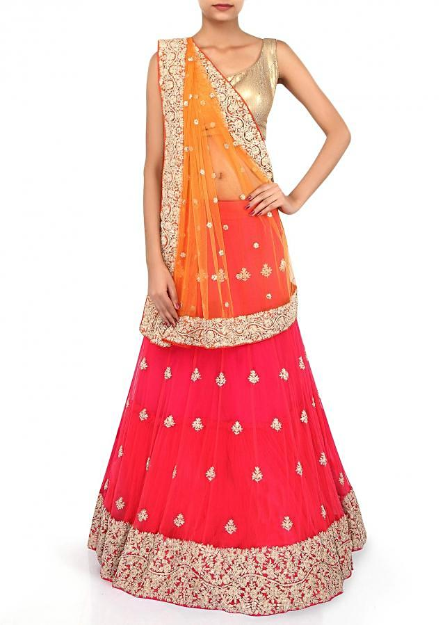 Lehenga saree featuring in orange and red adorn in zari embroidery only on Kalki