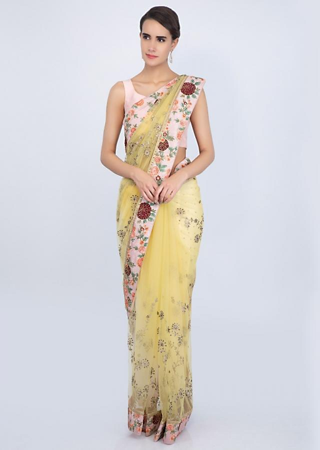 Lemon Yellow Saree In Net With Contrasting Pink Raw Silk Embroidered Border Online - Kalki Fashion