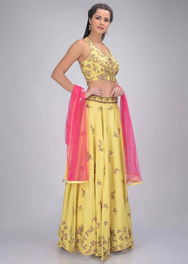 Lemon Yellow Lehenga Set In Satin Crepe With Fuchsia Net Dupatta Online - Kalki Fashion