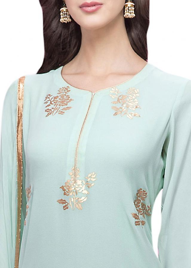 Light blue straight suit in gold applique embroidery