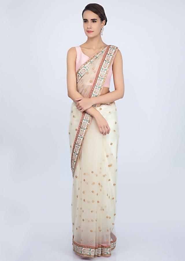 Light Cream Saree In Net With Floral Embroidered Butti And Border Online - Kalki Fashion