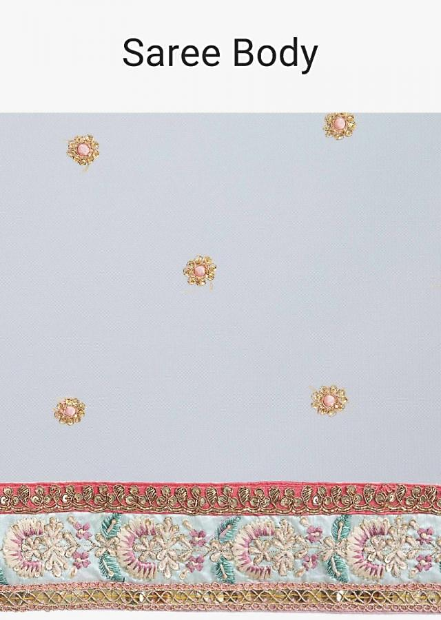 Light cream net saree with floral embroidered butti and border only on Kalki
