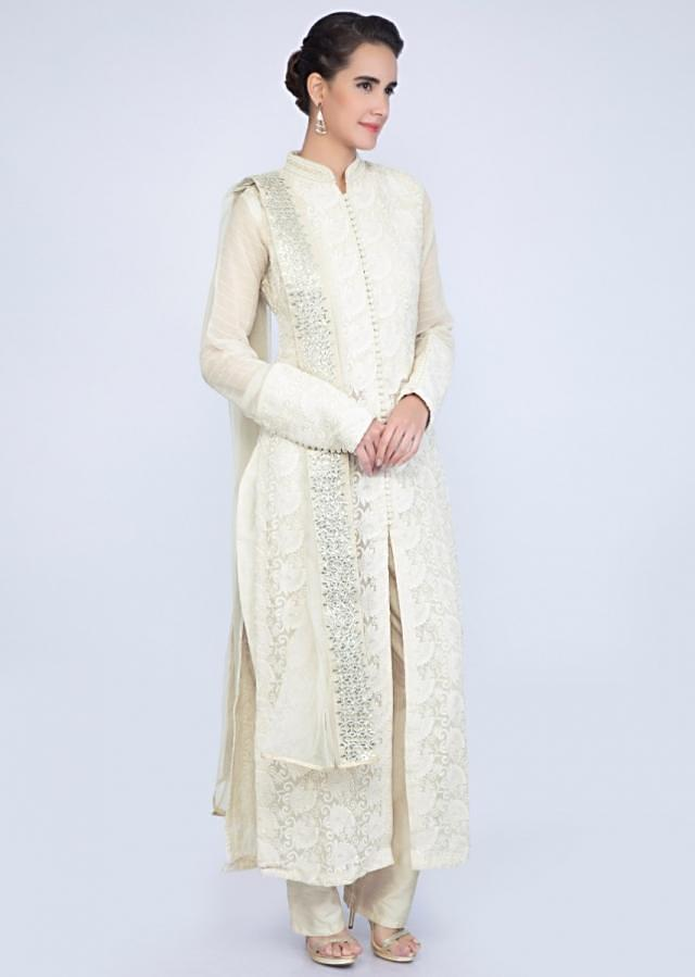 Light Cream Thread Embroidered Chiffon Suit With Raw Silk Pant And Net Dupatta Online - Kalki Fashion