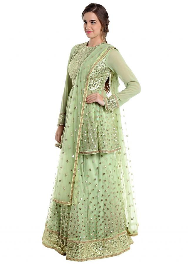 Light green net lehenga and blouse adorned with sequins only on Kalki