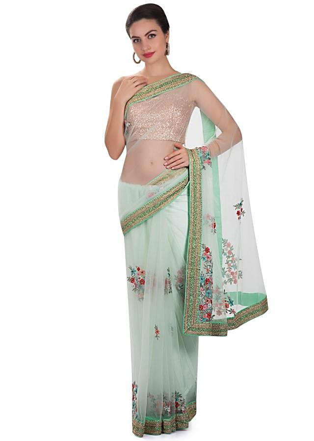 Light green net saree embellished with resham and cut dana only on Kalki