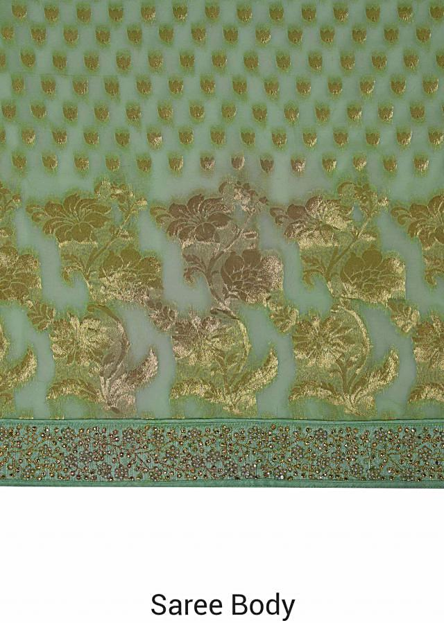 Light green saree in georgette with weaved butti and border only on Kalki