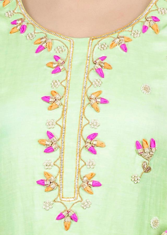 Light green sharara suit  with floral embroidered butti only on kalki
