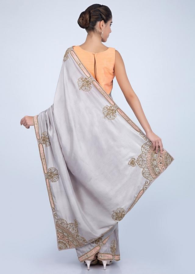 Light grey dupion silk saree with beautiful detailed border only on kalki