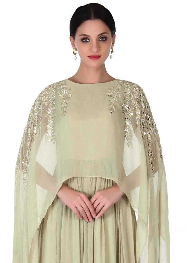 Light olive green suit with attached cape only on Kalki