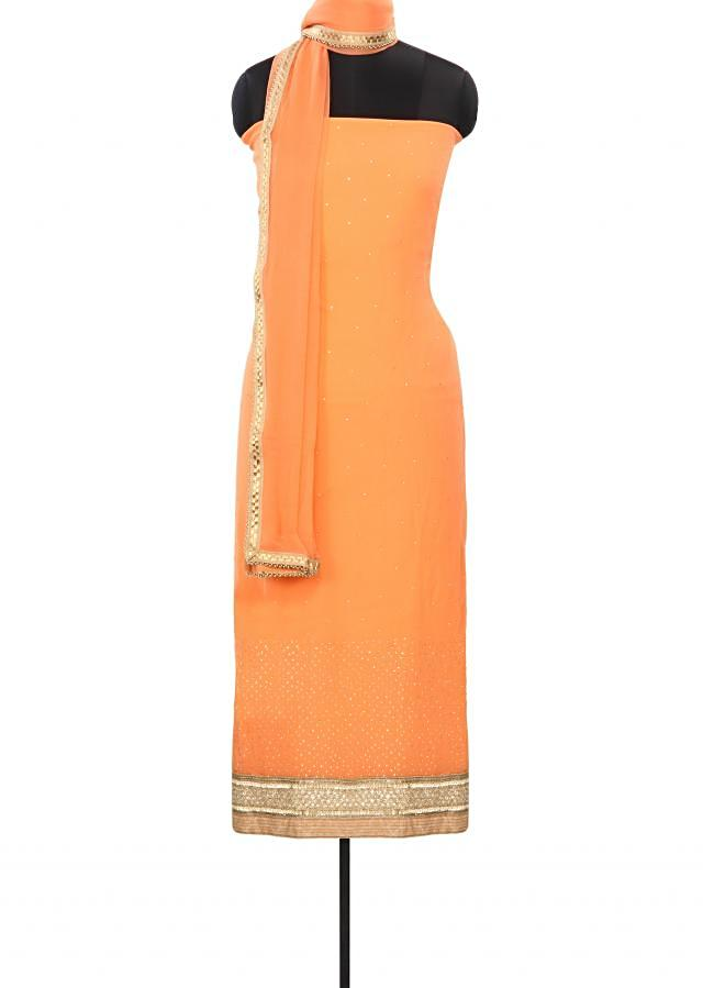 Light orange unstitched suit enhanced in kundan and zari embroidery only on Kalki