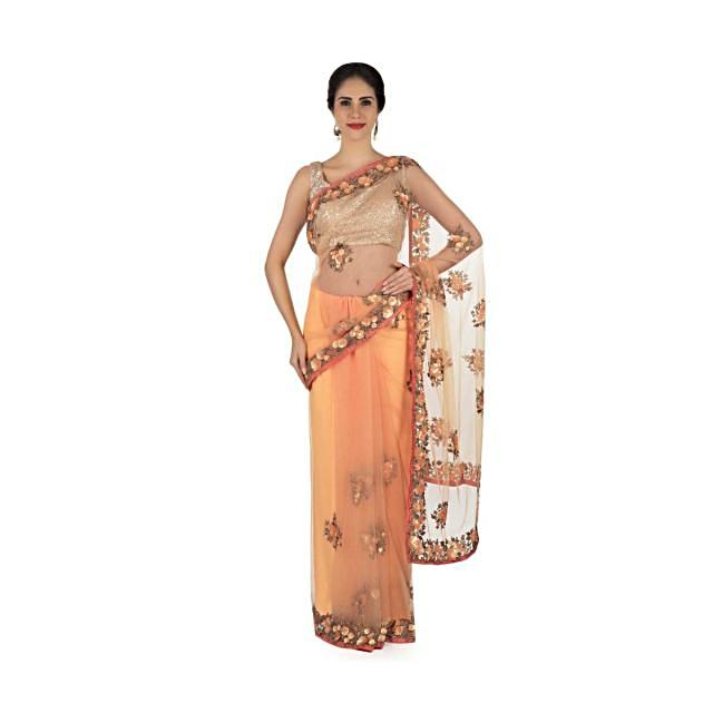 Light peach saree in net with sequin and cut dana work in floral motif only on Kalki