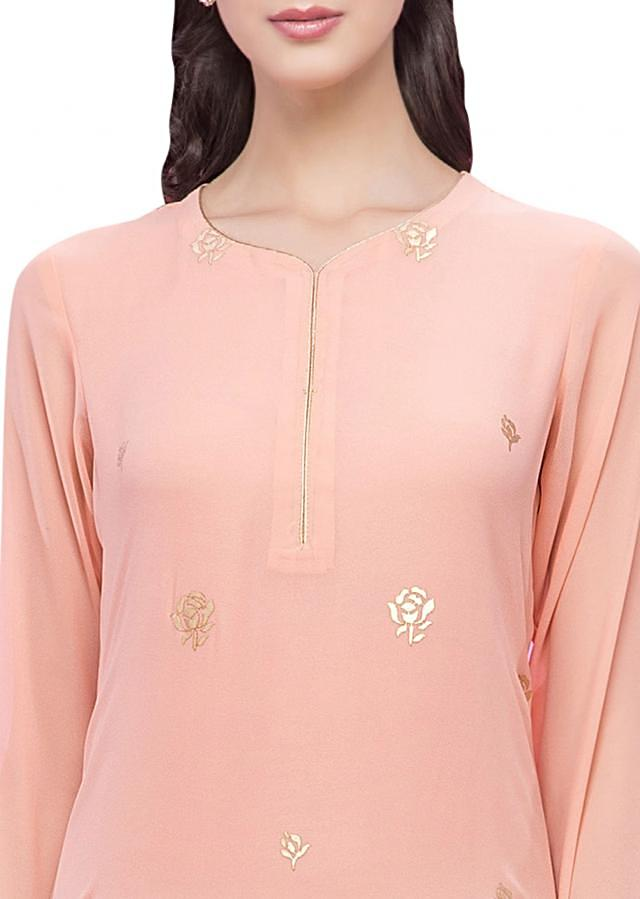 Light peach straight suit in gold applique embroidery
