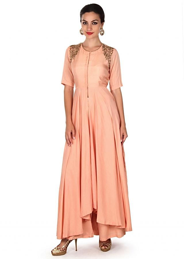 Light peach suit with embellished arm hole only on Kalki