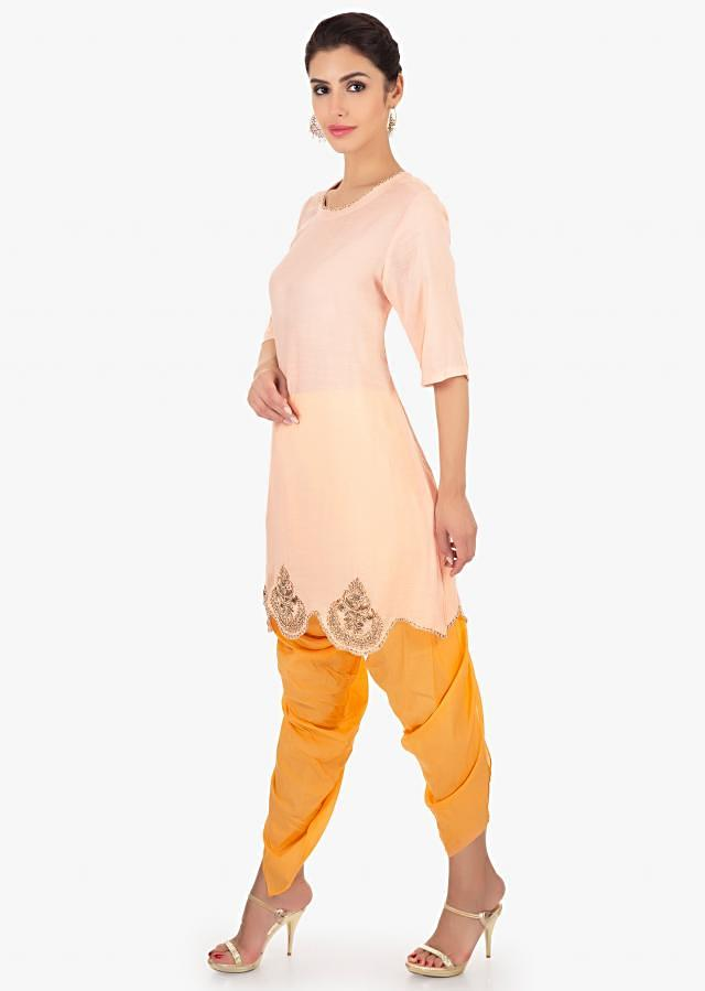 Light Peach Top Paired With A Yellow Dhoti Pant Online - Kalki Fashion