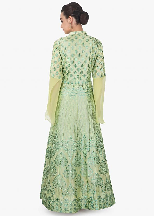 Light pista green suit featuring with foil printed butti and fancy buttons only on Kalki