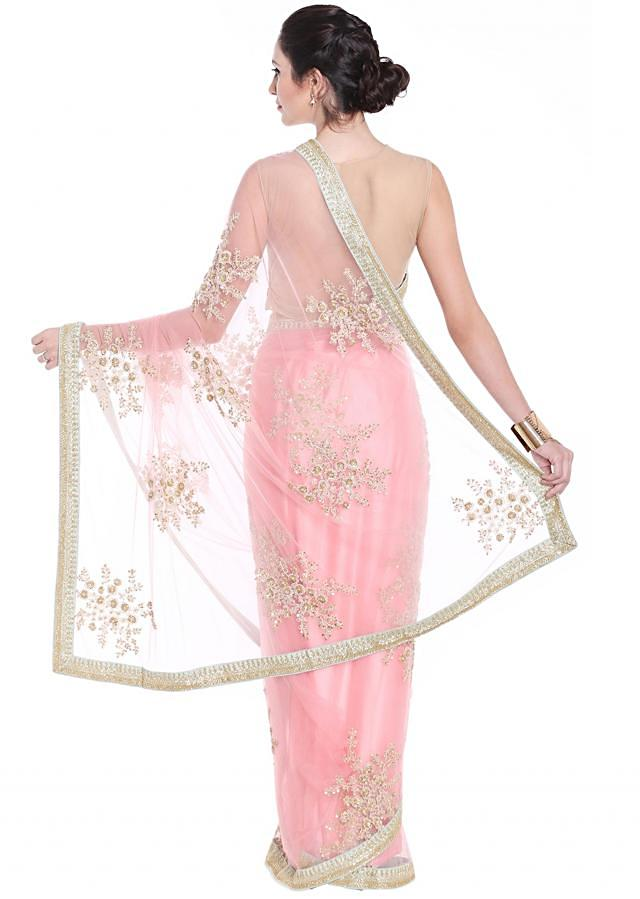 Light scarlet pink saree in zari and sequin butti all over only on Kalki