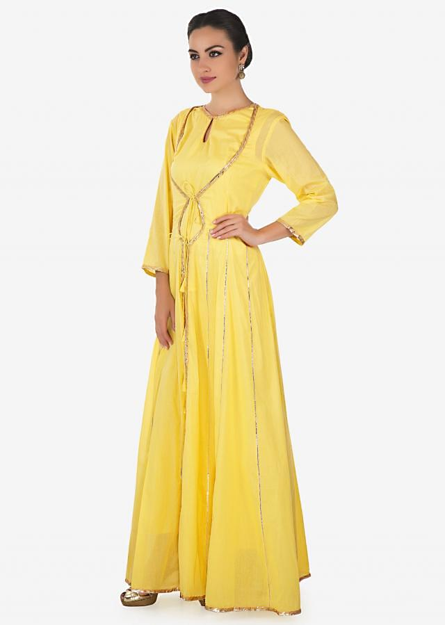 Light yellow A line dress with attach jacket in gotta lace only on Kalki