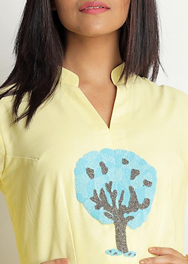 Light yellow tunic dress with blue and grey motif embroidered butti