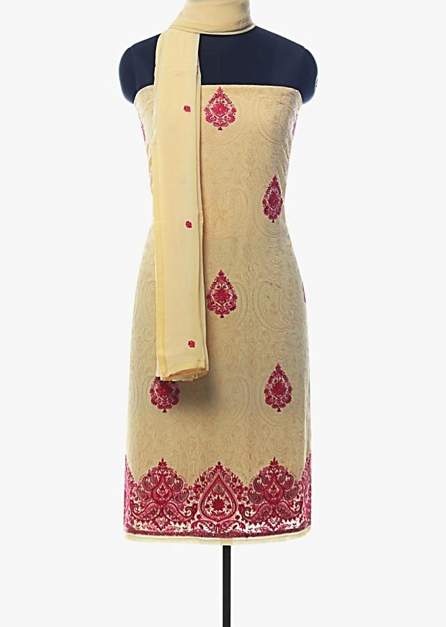 Light yellow unstitched suit adorn in paisley motif embroidered butti and border only on Kalki