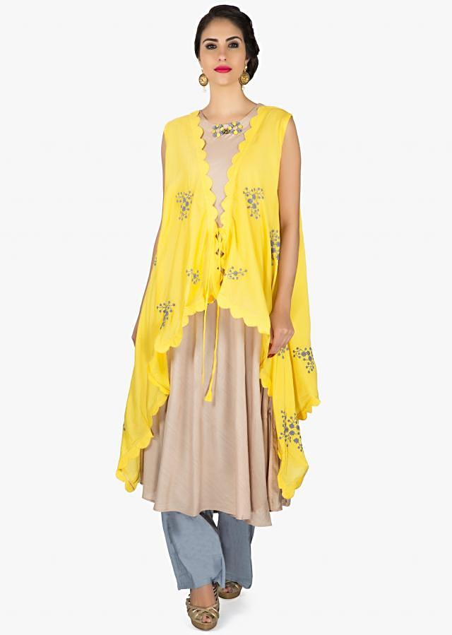 Light beige suit with yellow embroidered jacket only on Kalki