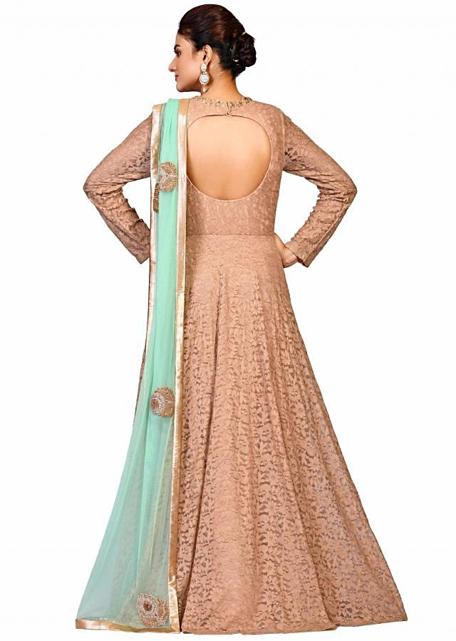 Light Brown fancy net gown with sea green chunni embellished in zardosi embroidery only on Kalki