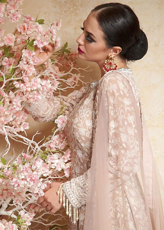 Light cream lehenga with long blouse in white thread embroidery with fancy tassel only on Kalki