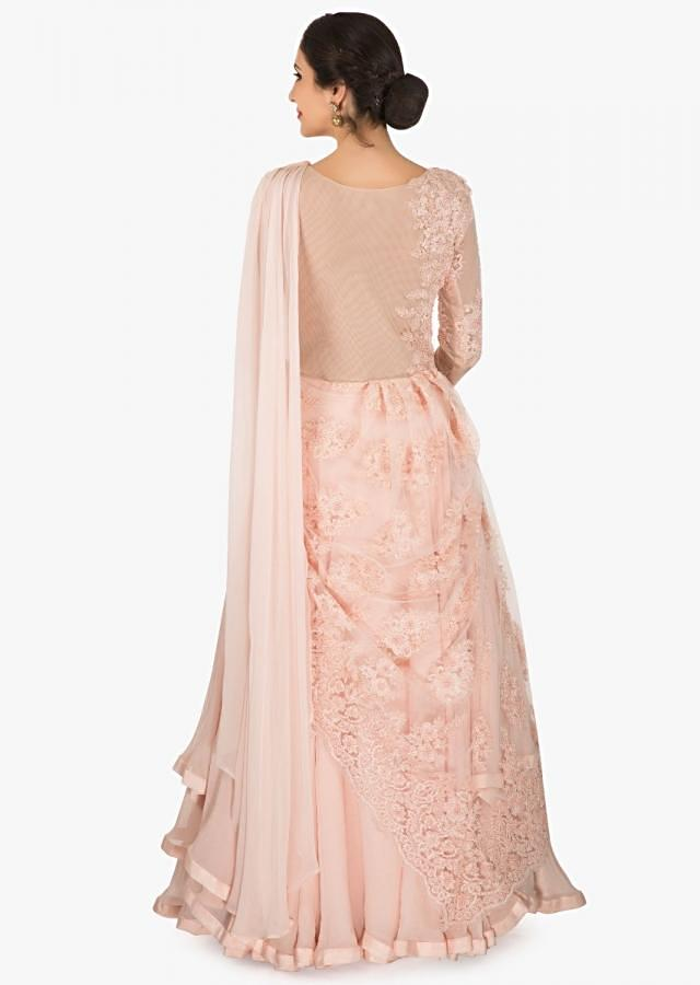 Light Peach gown in georgette with ready pleated pallav embellished with moti work only on Kalki