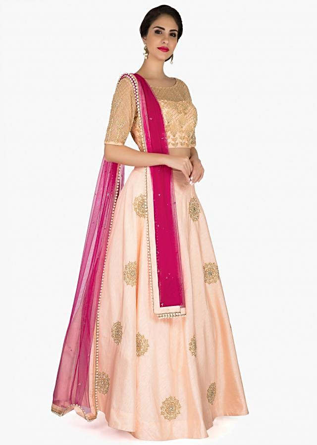 Light peach lehenga with ready blouse embellished in moti and cut dana embroidery only on Kalki