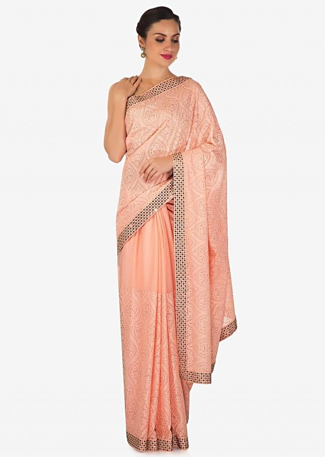 Light pink saree in georgette with thread and kundan work only on Kalki