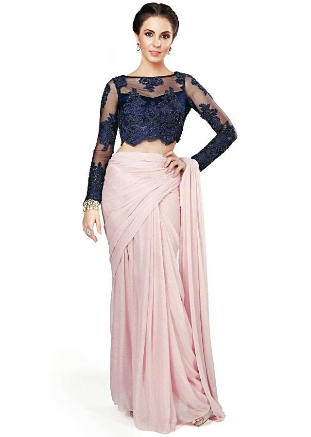 Light pink saree matched with navy blue embellished blouse only on Kalki