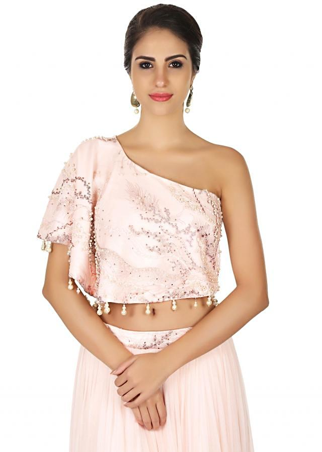 Light pink skirt with one shoulder cape in resham and pearl only on Kalki