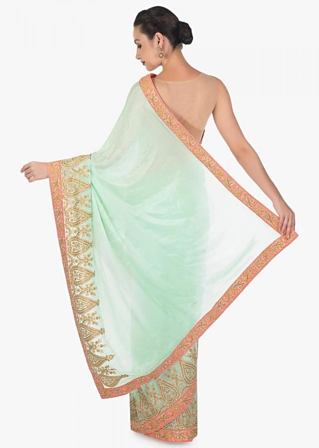 Light pista green saree in satin chiffon with zari and cut dana embroidered butti and border only on Kalki