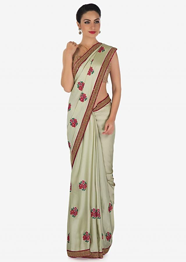 Light pista green saree in satin silk with resham embroidered butti and sequin border only on Kalki