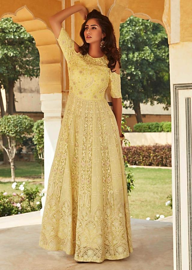 Light yellow anarkali suit in chiffon with floral and paisley motif embroidery only on Kalki