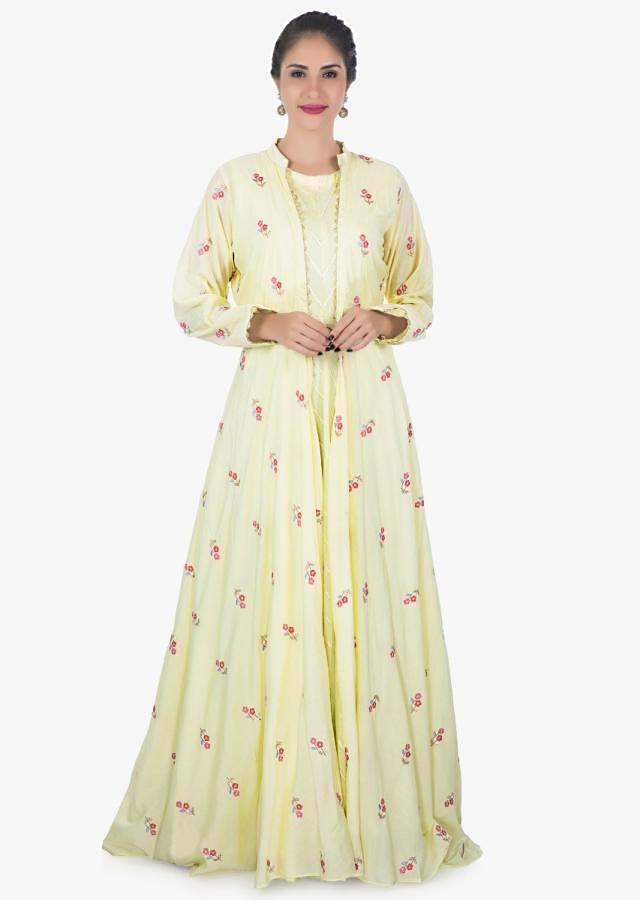 Lime green dress complimented with a matching jacket adorn in  resham embroidery only on kalki