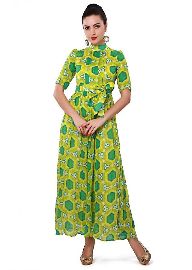 Lime green long kurti enhanced in floral print and pleats only on Kalki