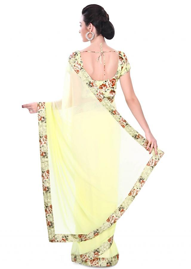 Lime green saree adorn in floral border only on Kalki