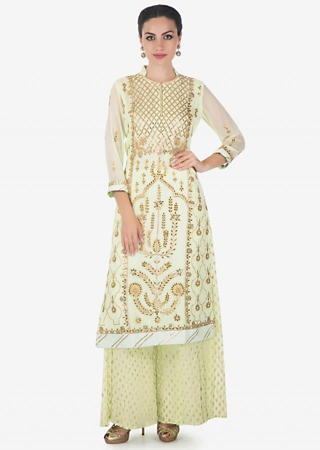 Lime green straight palazzo suit in georgette adorn in gotta patch, zari and moti work only on Kalki