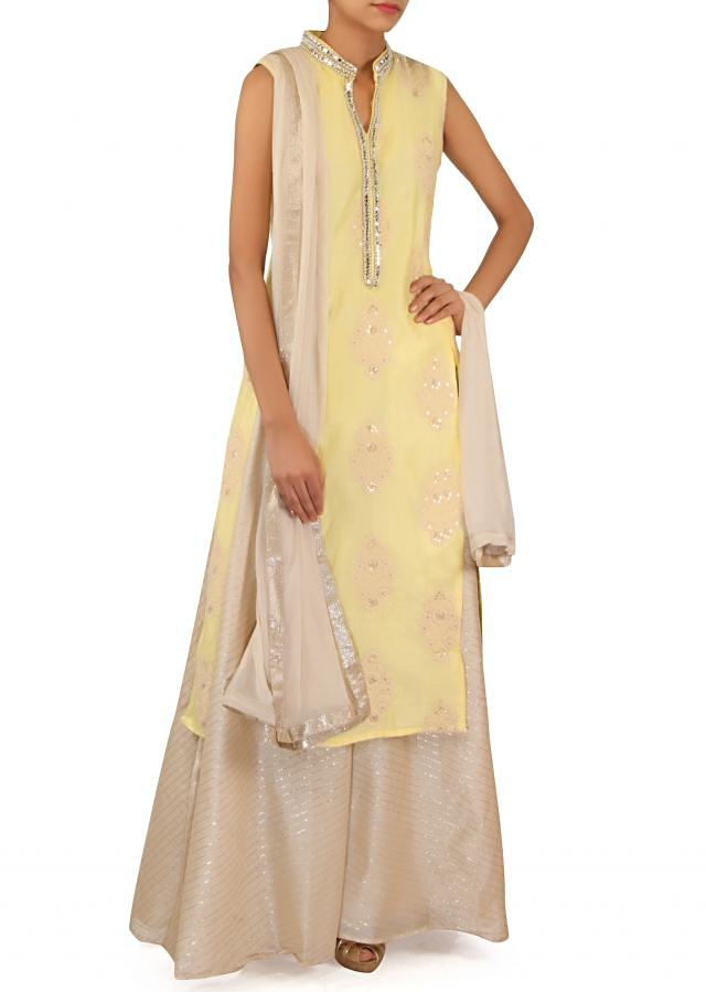 Lime straight suit adorn in thread embroider butti only on Kalki