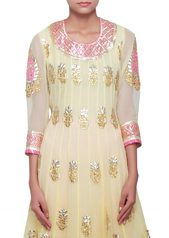 Lime yellow anarkali suit embellished in gotta patti only on Kalki