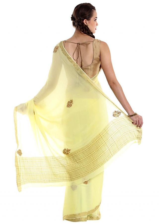 Lime yellow chiffon saree crafted with shimmering zardosi butti only on Kalki