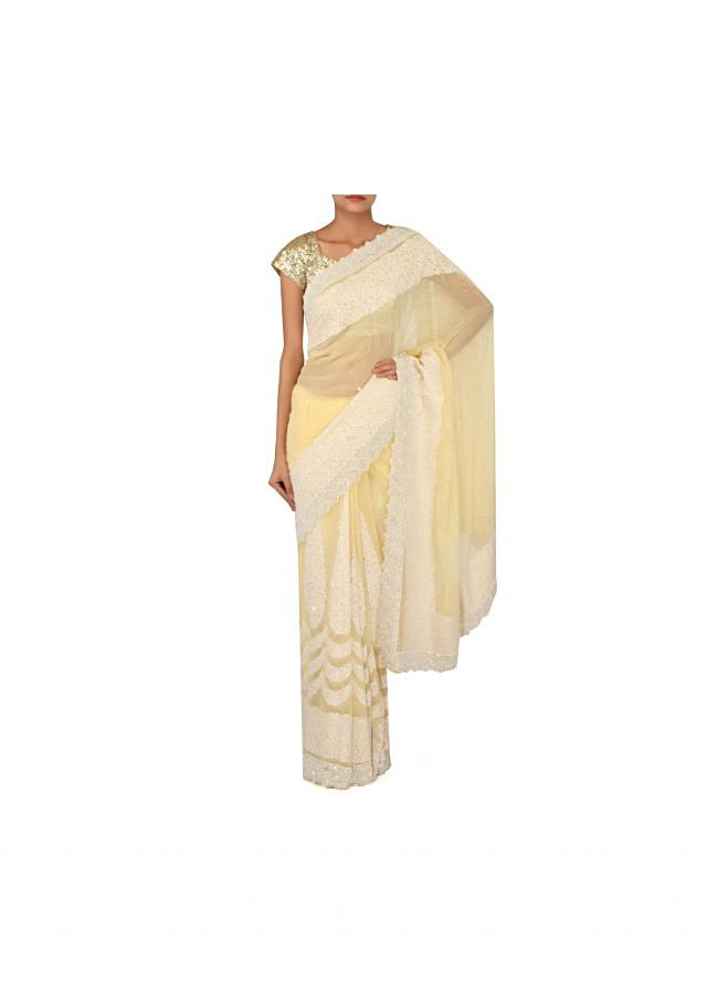 Lime yellow saree adorn in thread and pearl embroidery only on Kalki