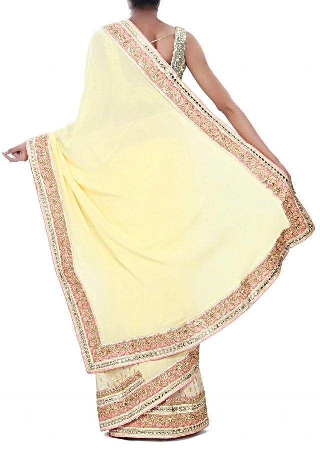 Lime yellow saree adorn in zari embroidered border only on Kalki