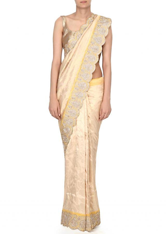 Lime yellow saree features in kundan border only on Kalki