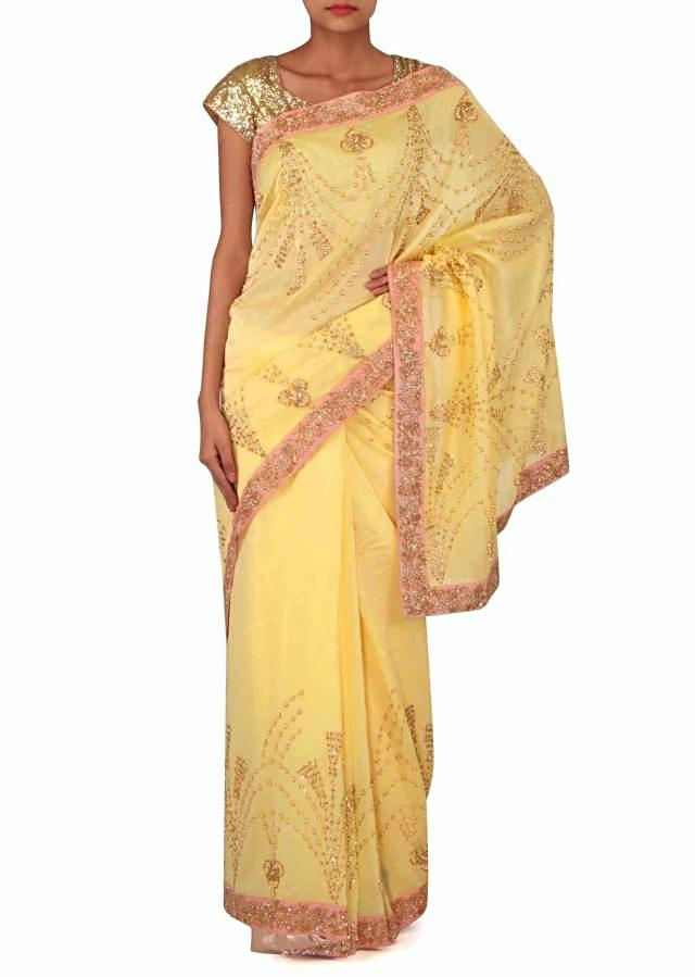 Lime yellow saree in pearl and zari embroidery only on Kalki