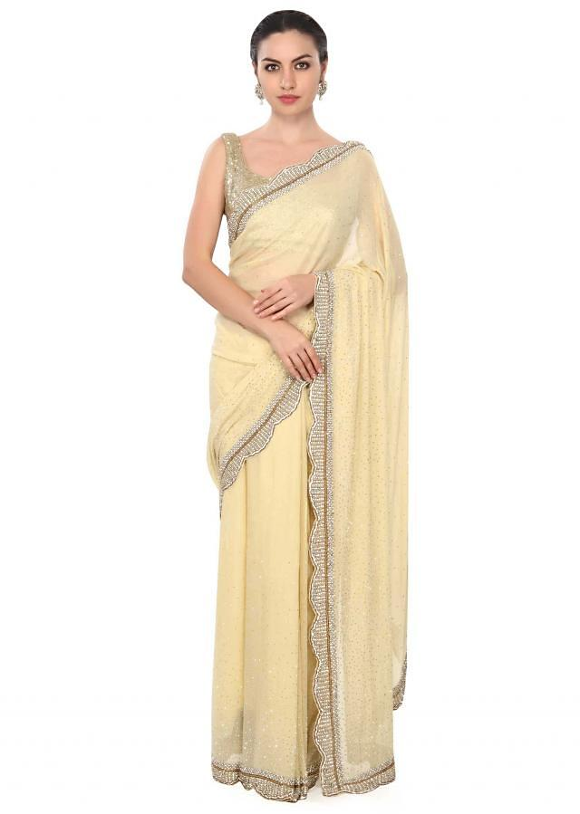 Lime yellow saree with stone and pearl border only on Kalki