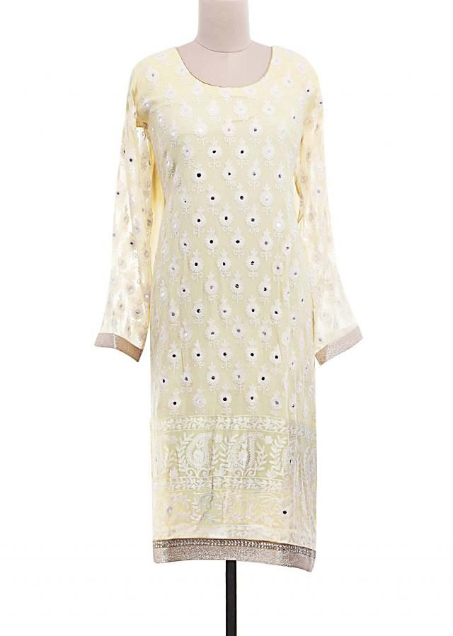 Lime yellow semi-stitched suit embellished in mirror and thread embroidery only on Kalki