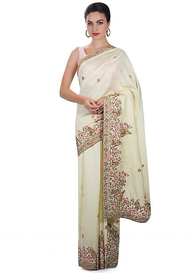 Lime yellow silk saree adorned with zardosi and resham work only on Kalki